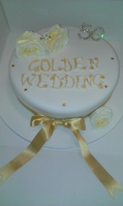 Golden wedding cake With edible sugar paste flowers. quote celebration 222